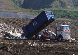 dump-truck-landfill-clothes-waste